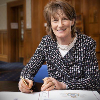Lord-Lieutenant of Shropshire Anna Turner Signing visitors book at RAF Shawbury