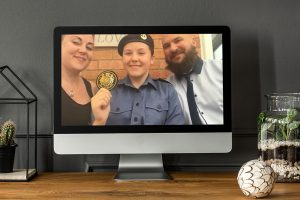 Cadet Charli Watkin from Telford representing the Sea Cadets with her parents
