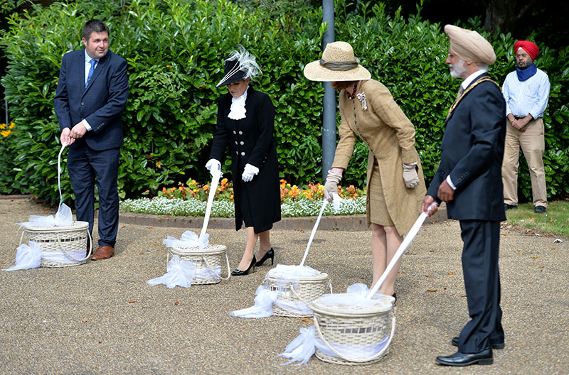 Lord-Lieutenant of Shropshire with others Releasing doves as a symbol of freedom on VJ 75 Commemoration Day in Telford Town Park.