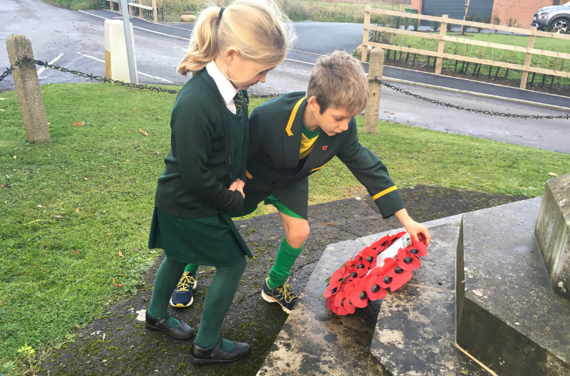 Children laying Remembrance Day wreath