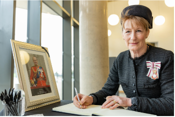 The Lord-Lieutenant of Shropshire, Anna Turner signing the book of condolence