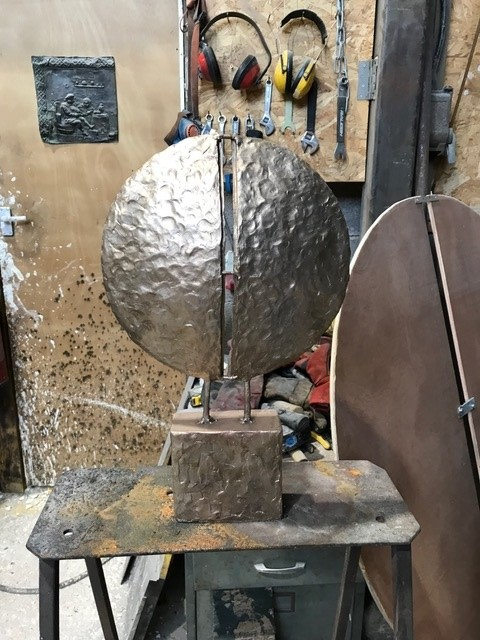 9 bronze maquette at 1 5th size sandblasted and ready for finishing.